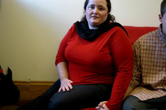 Meridith Viano's son, seated with her, spent days in a hospital waiting area until a psychiatric bed was made available.