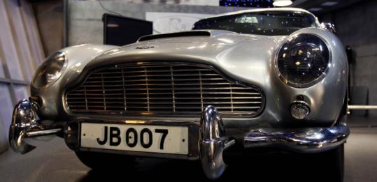 "The Aston Martin auctioned in London yesterday was featured in the James Bond films ""Goldfinger'' and ""Thunderball.''"