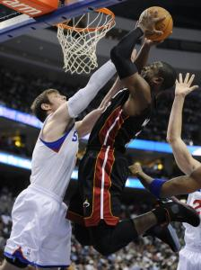Dwyane Wade had his eye on this basket over Andres Nocioni, and the Heat had eyes on their first victory of the season.