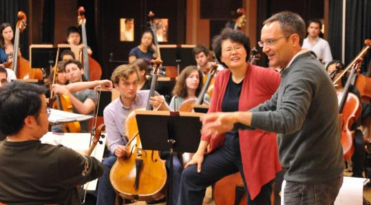 Composer Osvaldo Golijov (right) with conductor Mei-Ann Chen (in red), at rehearsal.