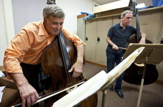Double bass players Lawrence Wolfe and Donald Palma rehearsing for Monday's concert.