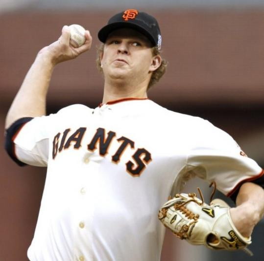 Matt Cain, who has thrown 21 1/3 scoreless postseason innings, allowed just four hits to lift the Giants into a 2-0 Series lead.