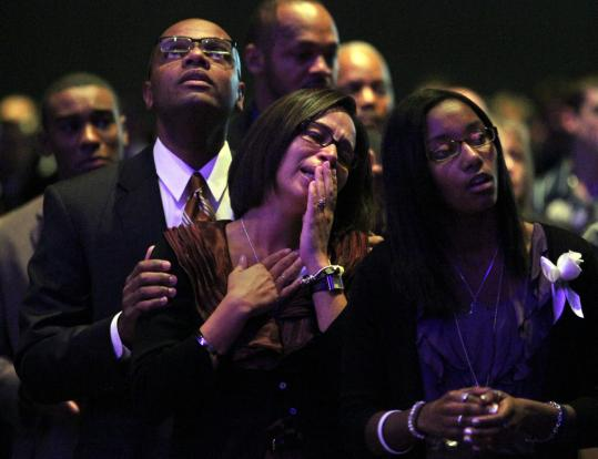 Members of Danroy Henry Jr.'s family — his father, Danroy Sr. (left), his mother, Angella (center), and younger sister, Amber — gathered at the Boston Convention & Exhibition Center to celebrate his life.