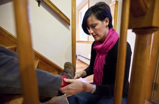 Danielle Champoux Bohnke of Melrose helps her son with his shoes. She is one of many parents who have concerns about bullying. For Susan, the horror began with a phone message about her daughter.
