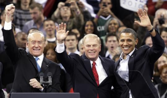 President Obama stumped at a Democratic campaign rally in Cleveland yesterday with Senate candidate Lee Fisher (left) and Ohio Governor Ted Strickland.
