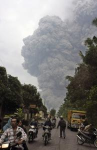 Residents who had returned home to check on livestock raced away as Mount Merapi again erupted near Central Java, Indonesia yesterday. No casualties were immediately reported.