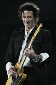 The Rolling Stones guitarist, shown performing at Fenway Park in August 2005, informs his bawdy, rambling autobiography with humor and sharp insights.
