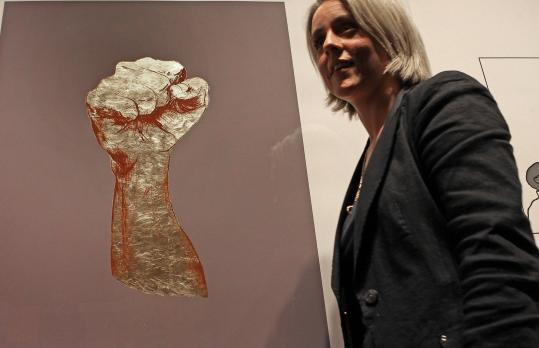 """Nicola Green, a British painter who followed the Obama presidential campaign, at her exhibit, """"In Seven Days . . .'' Next to her is """"The Second Day, Struggle'' in gold leaf."""