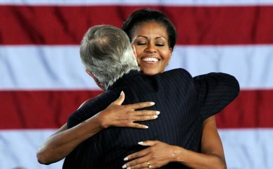 Michelle Obama hugged US Senate Majority Leader Harry Reid at a rally in North Las Vegas yesterday.