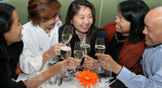 Friends toast Jeannie Suk (center) at Rialto. Pictured (from left): Linda Chin, Jody Adams, Dr. Mary Lee, and Paul Lee.
