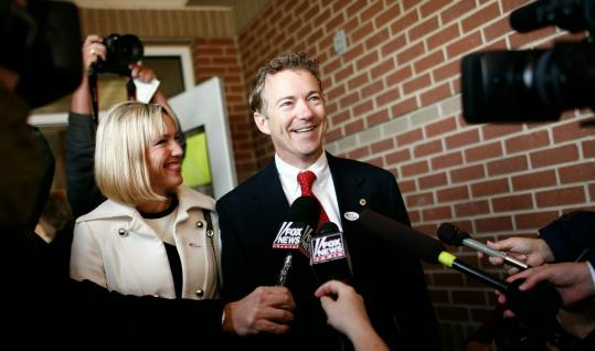Tea Party favorite Rand Paul, Kentucky's Republican candidate for the US Senate, easily won. He voted with his wife, Kelley.