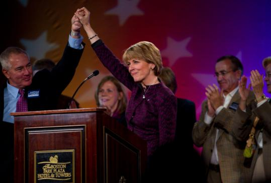 Martha Coakley celebrated her reelection as state attorney general last night with her husband,