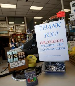 "Signs at Harrington Wine & Liquors in Chelmsford thanked voters for repealing the sales tax on alcohol. ""Now we look forward to our customers coming back,'' owner John Harrington said."