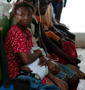 A woman waited for her cholera-stricken child to be treated at a hospital in Petite Riviere, Haiti, near the Artibonite River.