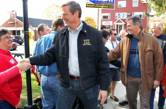 US Senator Scott Brown (right) joined GOP gubernatorial candidate Charles D. Baker Saturday at a stop in Foxborough.