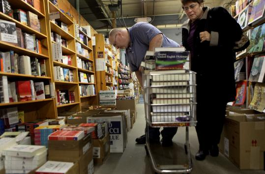Shoppers Christina Reusser and Jim Emard found the half-century old bookstore to be a tight squeeze.
