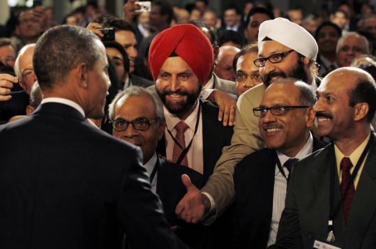 President Obama met with audience members after speaking at a gathering of US and Indian business executives in Mumbai yesterday. He said his move to ease restrictions on US exports to India is aimed at creating jobs.