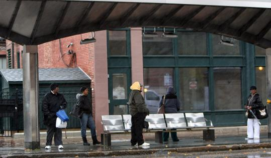 The MBTA is using federal stimulus money to install laminated glass windscreens at 25 Silver Line Washington Street bus shelters to protect waiting riders from the elements.