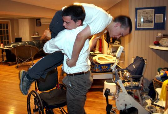 Brandon Coppola lifted and carried brother Jared from his wheelchair in the bedroom to the kitchen upstairs.