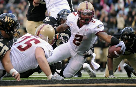 BC's Montel Harris extends the ball over the goal line for a second-quarter touchdown.