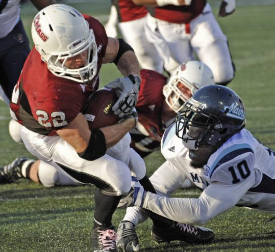 UMass&#8217;s Jonathan Hernandez breaks the tackle of Maine&#8217;s Donte Dennis to score on a 7-yard reception.