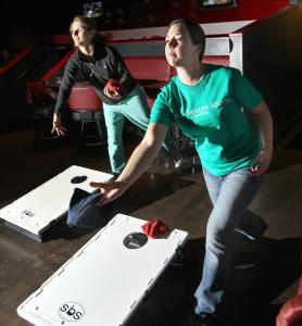 Katie Powell (left) of Brookline and Lauren McCourt of Boston let fly at Game On! last month.