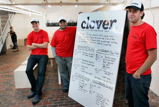 From left: general manager Chris Anderson, executive chef Rolando Robledo, and founder Ayr Muir with Clover's menu.