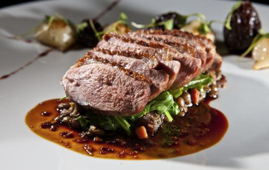 Spice-coated duck breast over lentils.