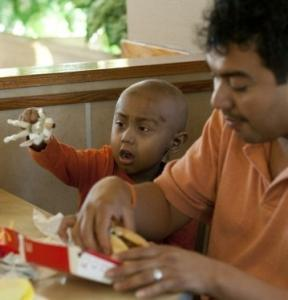 Andy Villatoro, 5, shown with his father, Carlos, played with his McDonald's Happy Meal toy in San Francisco.