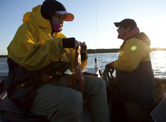Sarah Palin and her husband, Todd, on a fishing trip. The Palins are the stars of a new TLC series.