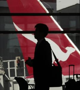A passenger waited to board a Qantas jet yesterday in Sydney. The Rolls-Royce Trent 900 is a technologically advanced engine in 20 Airbus A380s around the world.