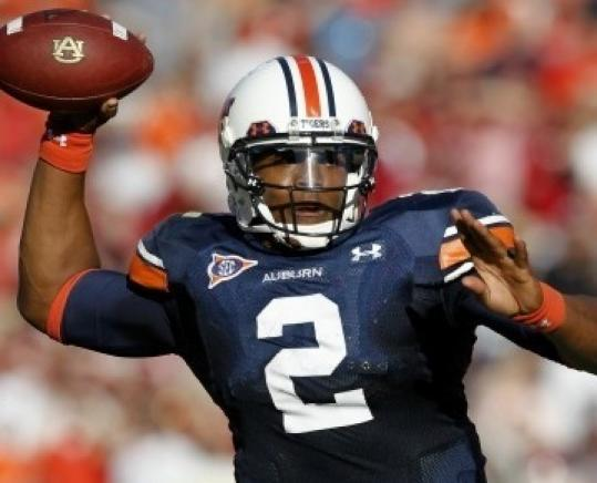 Controversy over his recruitment continues to dog Auburn QB Cam Newton.
