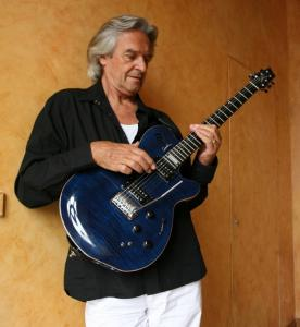 "John McLaughlin's latest album, ""To the One,'' was inspired by John Coltrane's ""A Love Supreme.''"