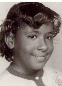 Marie Evans is pictured at age 9.