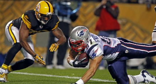 Rob Gronkowski dives into the end zone in front of the Steelers' Ryan Clark for his first of 3 TDs.
