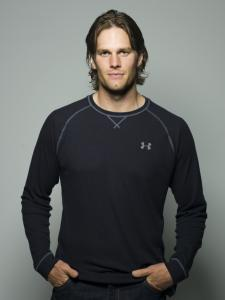 Tom Brady wore an Under Armour shirt after agreeing to become a spokesman for the firm.