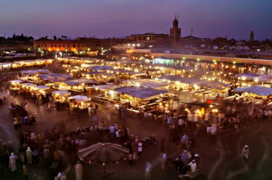 At night in the ancient medina, the large plaza in Marrakech, Morocco, the Djemaa el-Fna glitters with about 100 food stalls.