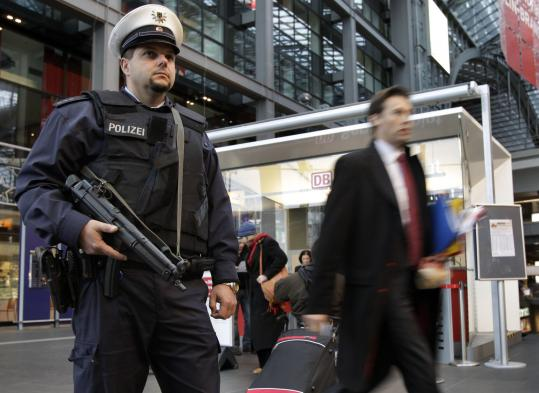 A German police officer, wearing a protective vest, patrolled the main train station in Berlin yesterday. Security was raised in Germany after new, tangible intelligence came to light over terrorist threats, Interior Minister Thomas de Maiziere said.