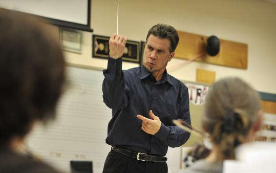 Jonathan McPhee has brought together two orchestras he directs. They'll play Mahler's Eighth in their hometowns.