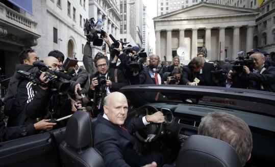 Dan Akerson , General Motors chief executive, sat in a 2011 Chevrolet Camaro at the New York Stock Exchange yesterday