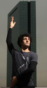 Lasha Khozashvili, a new principal dancer with Boston Ballet, at the troupe's headquarters, with the John Hancock Building outside the window.