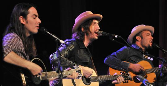 Fistful of Mercy — (from left) Dhani Harrison, Joseph Arthur, and Ben Harper — performing Thursday night at the Somerville Theatre.