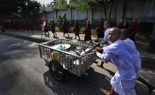 Buddhist monks walked along the streets in Yangon, Myanmar. The country recently held its first election in 20 years, but it was widely seen as a ploy by the government.
