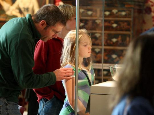 Cooper Toulmin of Lexington and his children Zoe and Cooper gazed at a display in the MFA's new wing yesterday.