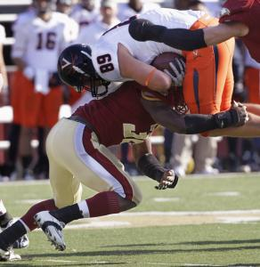 BC defensive tackle Dillon Quinn stops Virginia tight end Colter Phillips in his tracks.