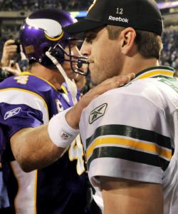 Brett Favre (left) and Aaron Rodgers part ways after their teams continued headed in opposite directions.