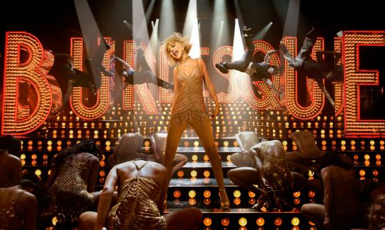 "Christina Aguilera's big voice and natural screen presence help boost her performance in ""Burlesque,'' but she is outshined by showbiz veteran Cher."