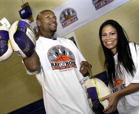Ray Allen and his wife, Shannon, giving away turkeys yesterday at Boston Centers for Youth & Families.