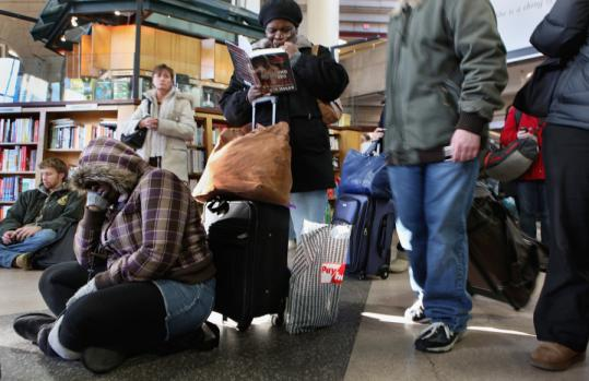 At South Station, Ariel Chambers and her mother, Ann Marie Chambers of New York City, waited to meet a family member.