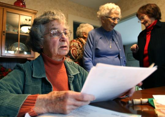 Margaret Atkins, 84, reminisced over old meeting dates of the Cabot Club in Middleborough as Anne Lovell, 96, and Ellen O. Grant, 86, talked to each other. The club has 15 members.